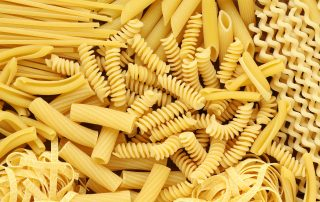 Variety of types and shapes of dry Italian pasta
